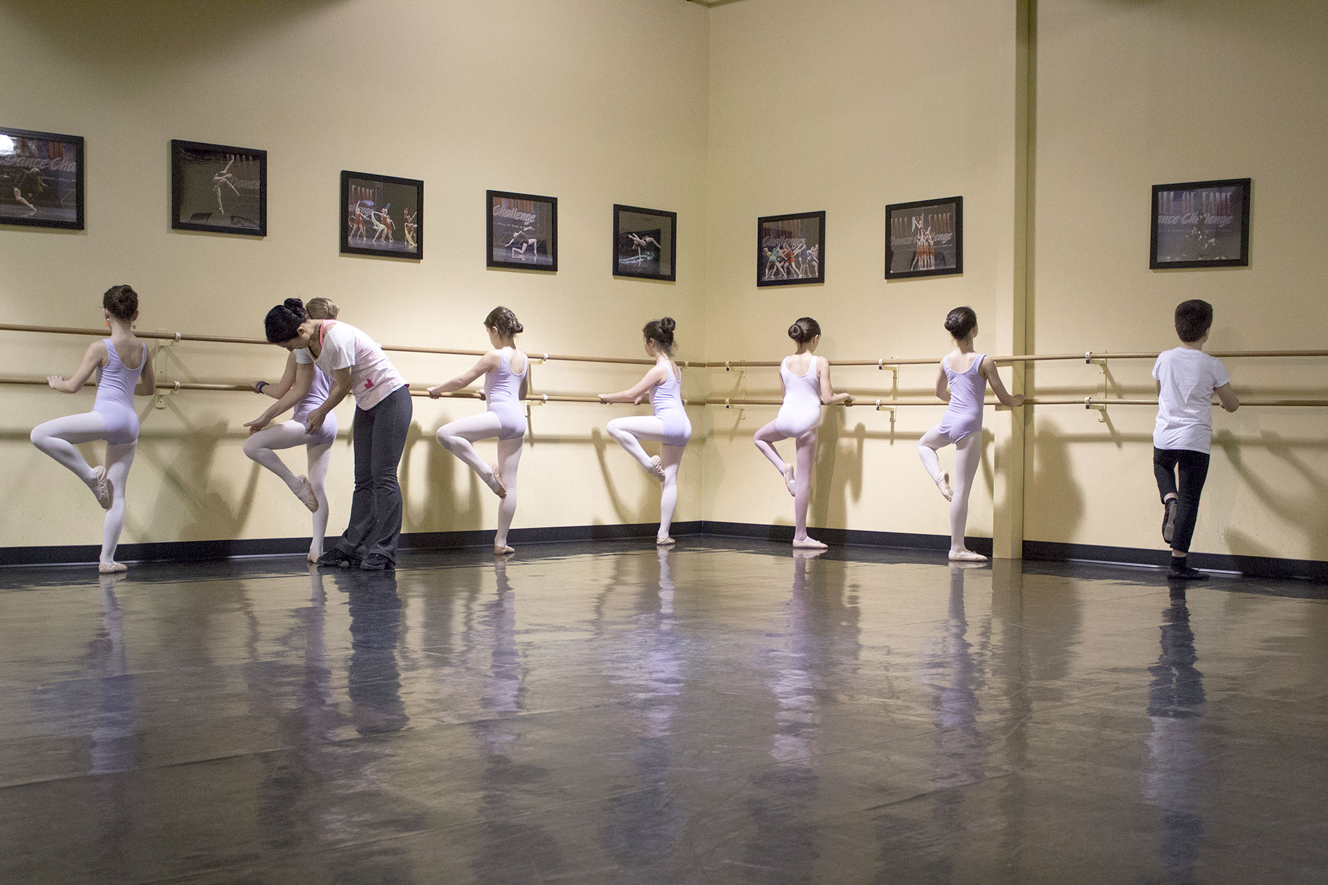 ballet instructor teaching children during dance classes in winnipeg manitoba