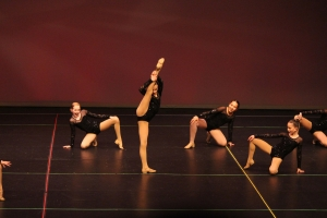 Youth performing jazz dance during recital in winnipeg manitoba